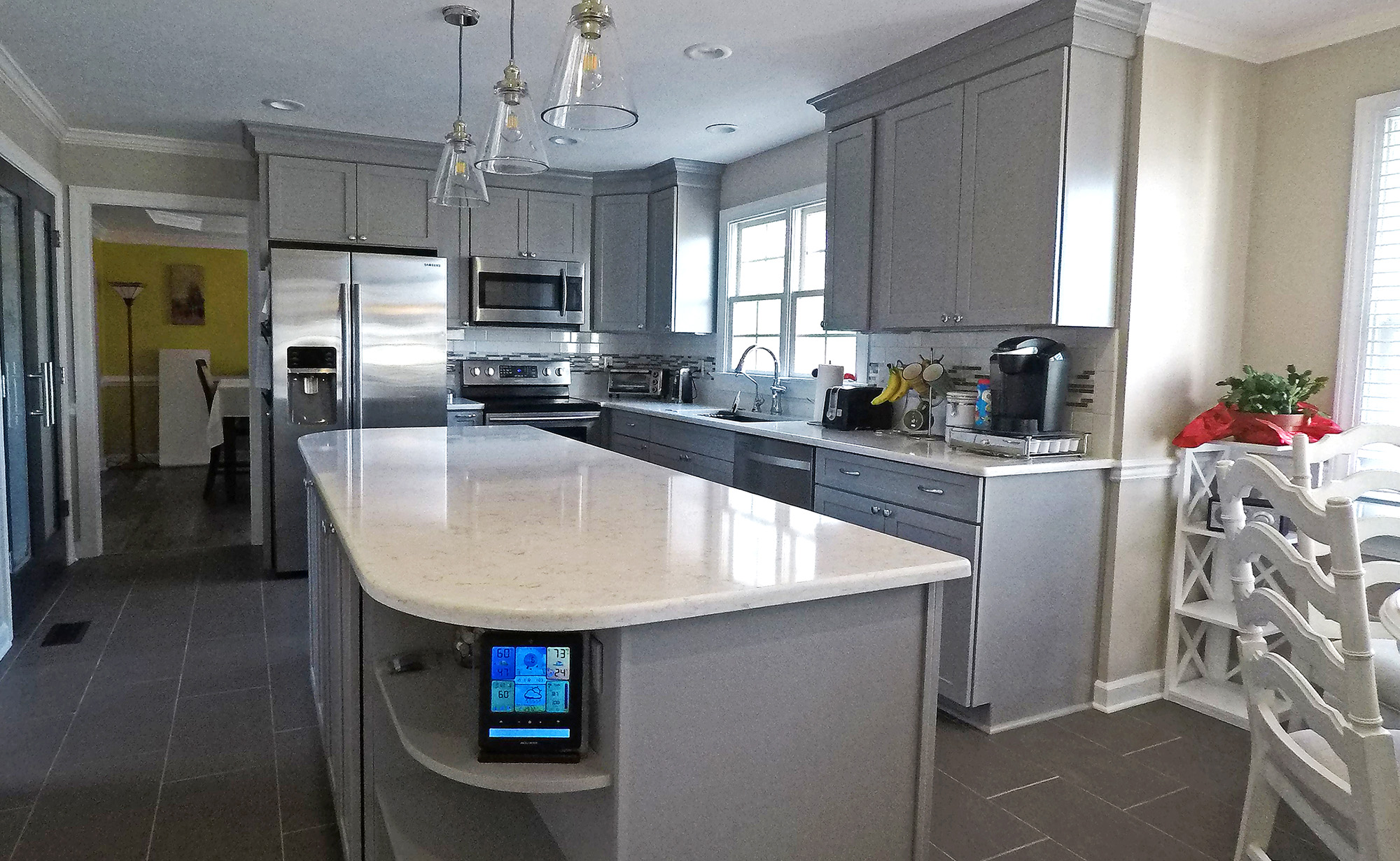 grey kitchen with marble counter tops