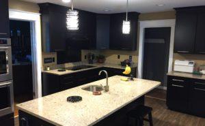 dark espresso kitchen cabinets with light granite countertops