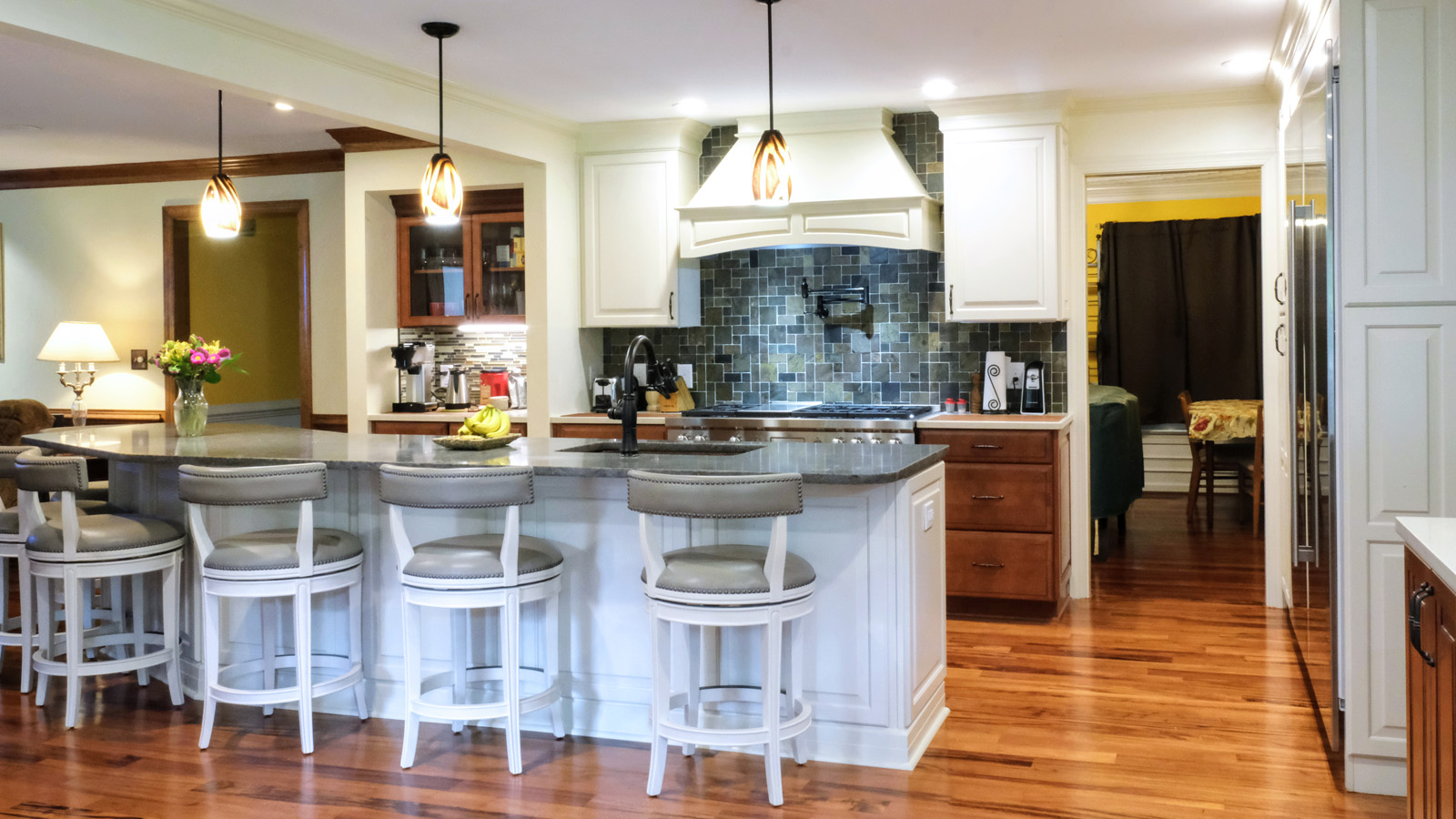 Large open concept kitchen, large sitting island, two toned cabinetry